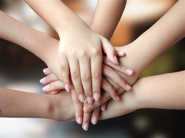 bigstockphoto_many_hands_success_3089491